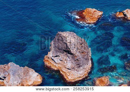 Colorful Rocks Of Mediterranean Sea In Azure Water, Malta