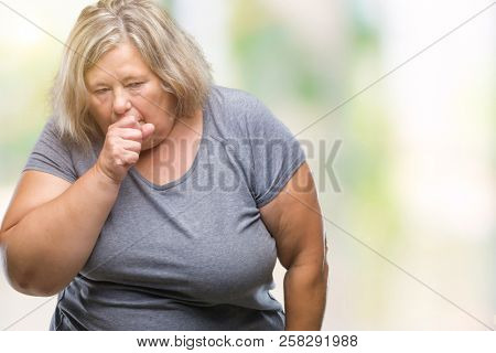 Senior plus size caucasian woman over isolated background feeling unwell and coughing as symptom for cold or bronchitis. Healthcare concept.