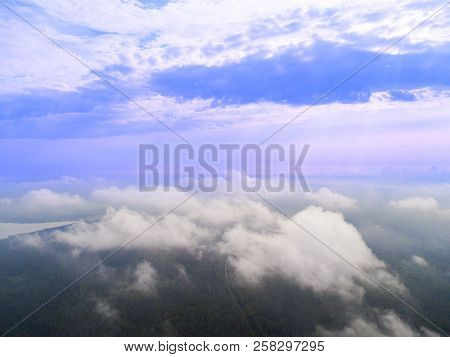 Aerial Drone View Clouds Over The Green Forest And Lake. Low Lying Cloud. Aerial View Of Over Tropic