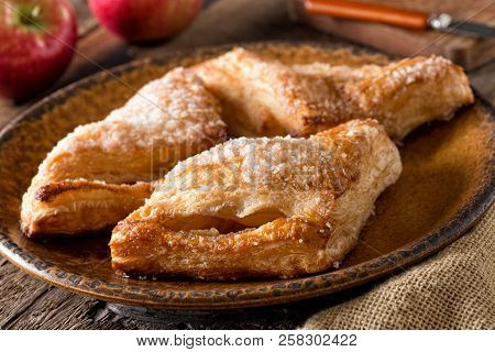 Delicious Freshly Baked Homemade Apple Turnovers With Coarse Sugar Topping.