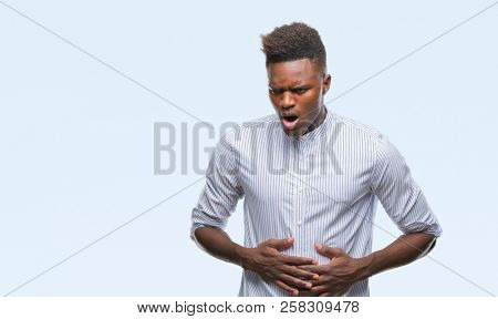 Young african american man over isolated background with hand on stomach because indigestion, painful illness feeling unwell. Ache concept.