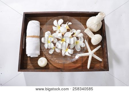 Many white frangipani in bowl, , candle, towel, herbal, ball,starfish, on basket