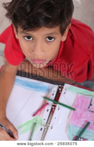 poster of Top-view of bored little boy at school