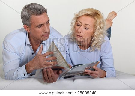Couple looking at a catalog