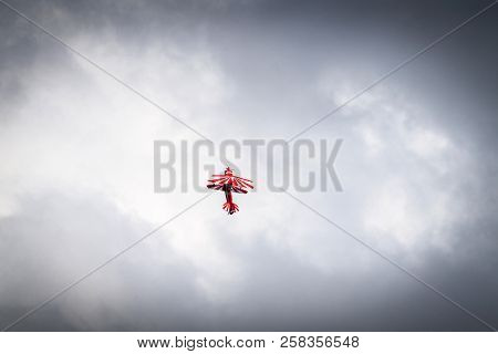 Airplane Flying Up In Cloudy Weather Trying To Make A Loop