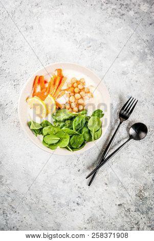 Modern Vegan Food, Savory Yogurt Bowl With Beans, Chickpeas, Spinach, Spicy Carrots, Lemon, Gray Sto