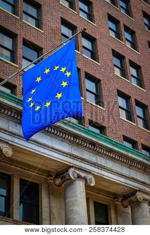 The Flag Of The European Union Blowing In The Wind On A Philadelphia Street.