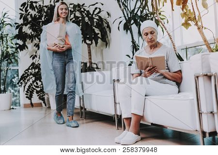 Patient Undergoes Rehabilitation. Cancer Patient On Sofa. Woman With Daughter. Woman Glad See Daught