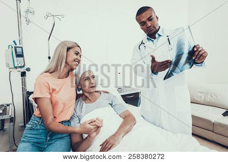 Woman With Mother. Cancer Patient. Doctor Looks X-ray. Glad Patient. Doctor In Ward. Woman On The Me