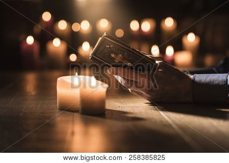 Man Reading The Holy Bible And Praying In The Church