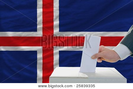 Man Voting On Elections In Iceland In Front Of Flag