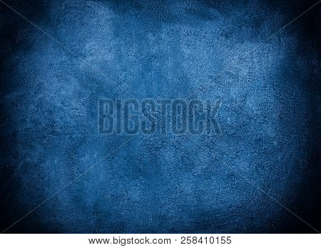 Dark Blue Grunge Marble Or Concrete Background With Dark Edges (as An Abstract Grunge Background Or