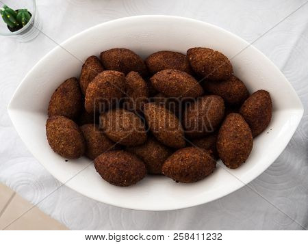 A Plate With Kibbe, A Famous Arabic Food From Lebanon