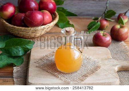 A Bottle Of Raw Unfiltered Apple Cider Vinegar On A Table