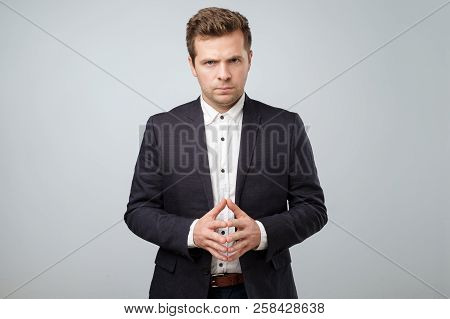 Fashion Trendy Elegant Young Caucasian Man In Dark Blue Suit Posing Looking Camera