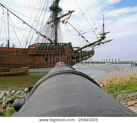 Canon pointed at a historic sailboat
