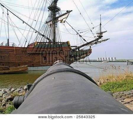 Canon pointed at a historic sailboat
