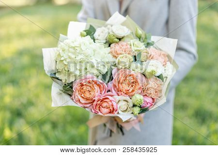 Close-up Beautiful Spring Bouquet In Hands. Delicate Flower Arrangement With Pink And Green Pastel C