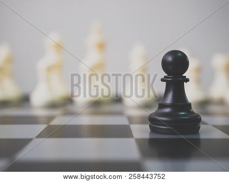 Strategic Planning Business Competition Concept. Black Pawn Surrounded By White Chess Pieces On A Ch