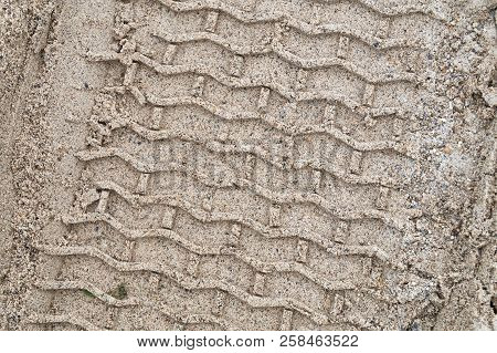 Tire Tracks In The Sand During Construction.