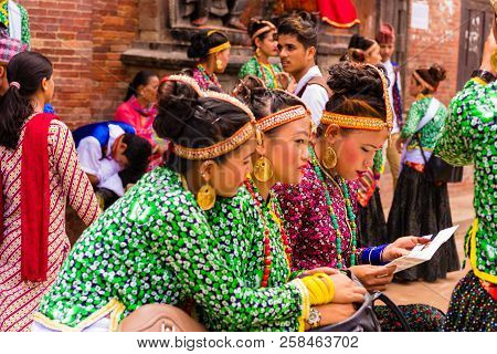 Group Of Dancers Wearing Traditional Costumes In Patan Durbar Square, Kathmandu Valley, Nepal