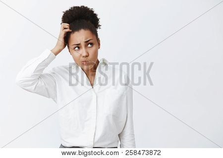 Hmm, I Do Not Know What To Do. Portrait Of Questioned Unaware Or Uncertaing Cute Office Worker With