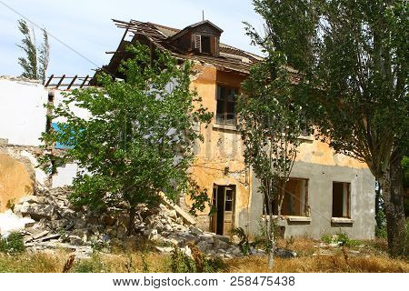 Russia, Crimea, Kerch - May 27, 2018: Damaged Old House. Architecture Image. Illustrative Editorial