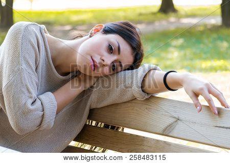 Portrait Of Girl Feeling Seasonal Depression Alone