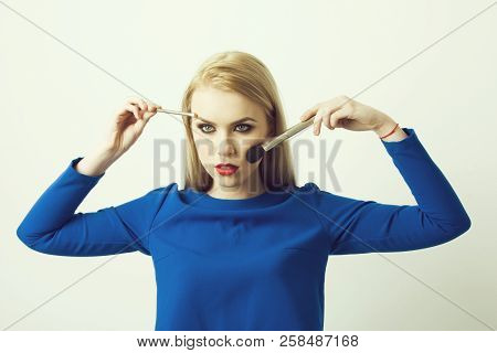 Woman With Makeup Brushes On Face Applying Powder And Eye Shadow. Pretty Girl With Red Lips And Fash