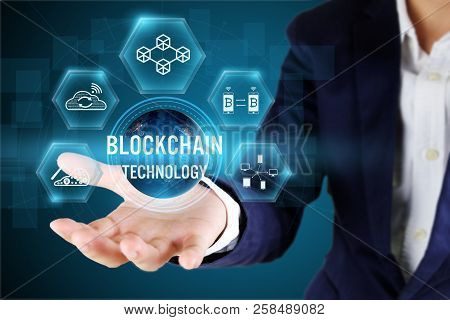 Businessman Holding Blockchain Icon On Virtual Screen,blockchain Technology Concept,elements Of This