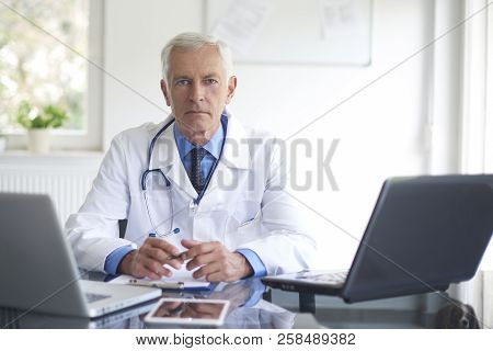 Male Doctor Portrait In The Consulting Room