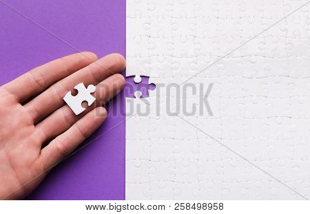 Meeting New Member Of Team Concept. Woman Holding One Missing Puzzle Piece, Top View, Copy Space