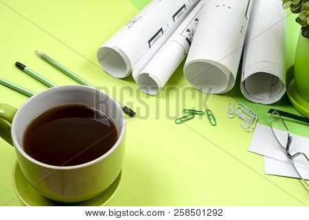 Workplace Of Architect - Rolls And Plans. Construction Background.
