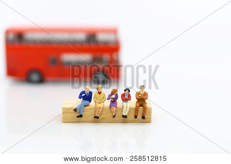 Miniature People: Passenger Waiting Bus At Bus Station For Go To Destination, Transportation. Image