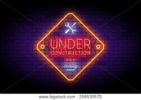 Under Construction Sign In Trendy Neon Style On The Brick Wall.