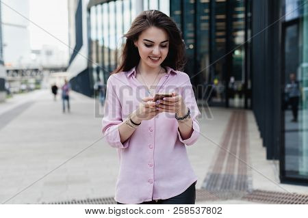 Happy Pretty Brunette Girl Or Businesswoman Using Mobile Phone, Beautiful Woman Browsing Phone And D