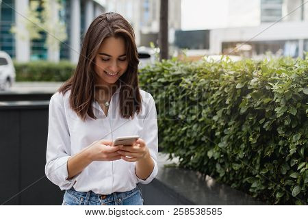 Happy Businesswoman Using Mobile Phone Near Office, Beautiful Woman Browsing Phone Smiling Walking O