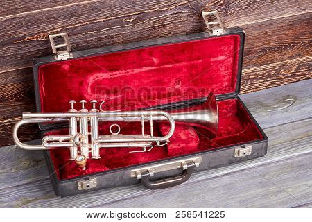Trumpet In Red Velvet Case. Classical Jazzy Instrument. Symphonic Music Equipment.