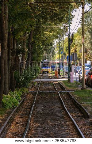 Szeged, Hungary, August 28: Public Tram, Rides On Uneven Rails Of A Dedicated Road On A Bright Sunny