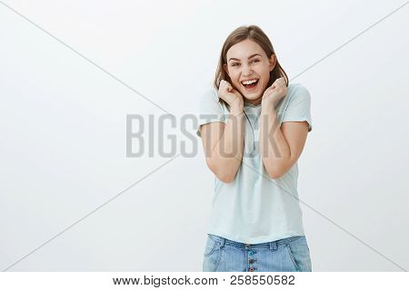 Girl Being Excited Visiting Concert For First Time. Charming Fascinated And Happy Young Woman In Tre
