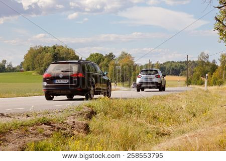 Jarna, Sweden - July 10, 2018: Cars On A Countryside Highway.