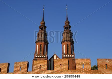 Church towers over brick