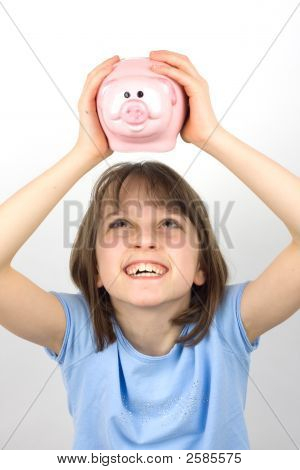 Girl Looking At Her Piggy Bank