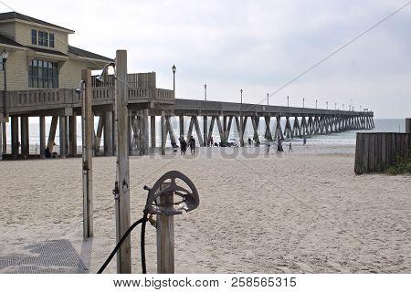 Long Shot Of Pier At Beach In  Wilmington, North Carolina