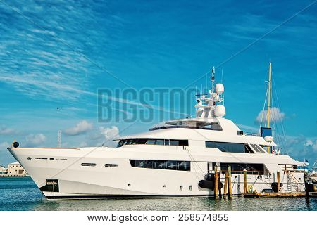 Cruise Touristic Boat Or Yacht On Water In Bay On Blue Cloudy Sky Natural Background Sunny Summer Ou