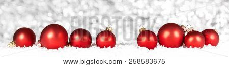 Red Christmas Balls In The Snow, White Sparkling Background, Panorama