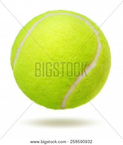 Close-up Of Green Tennis Ball Over White Background
