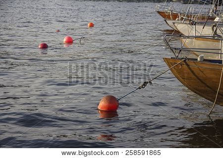 Nautical Part Of A Yacht With Cords, Rigging, Sail, Mast, Anchor, Knots On Yachts Tied Up To Buoys A
