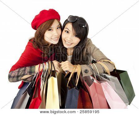 happy asian girls holding shopping bag