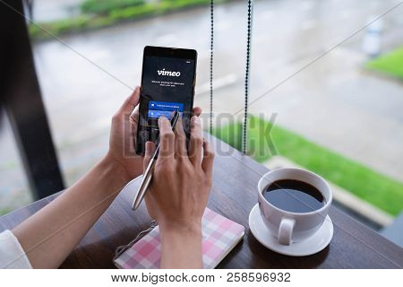 Chiang Mai, Thailand - August 18,2018: Woman Hands Holding Huawei With Vimeo On Screen.  Vimeo Is A